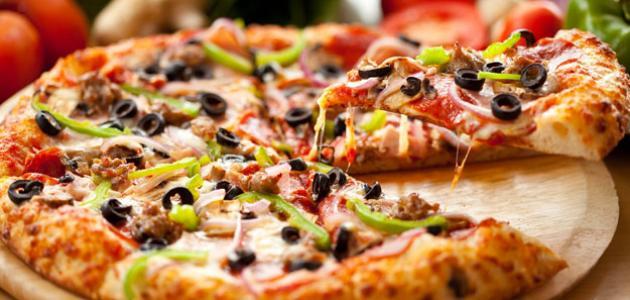 صورة طريقة عمل عجينة البيتزا الطرية