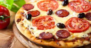 صور كيف تصنع البيتزا الجزائرية